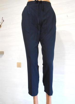 Красивые высокие темно синие  брюки