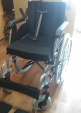 Инвалидная коляска.