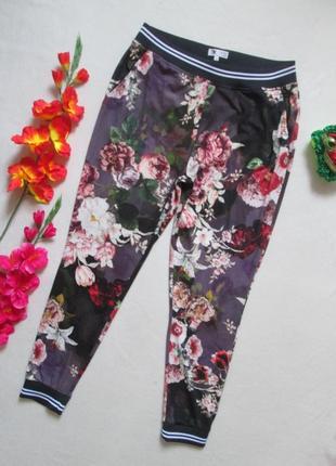 Шикарные брюки спортивного типа в цветочный принт с манжетами ...