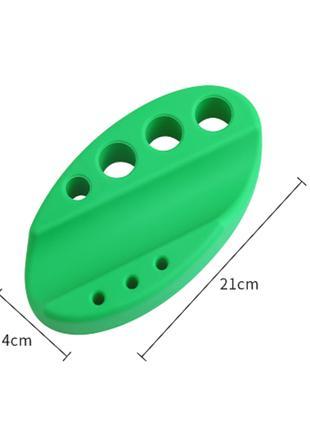 Подставка зеленая силиконовая для ручки и колпачков.
