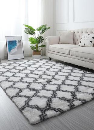 Дизайнерський килимок в білому кольорі