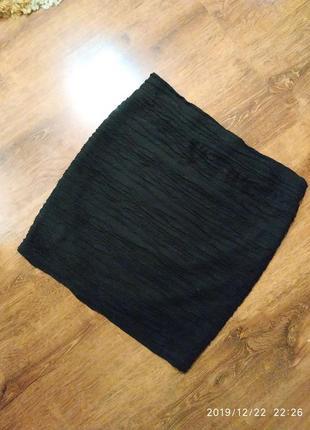 Красивая юбка с завышенной талией и объемной тканью рюшками