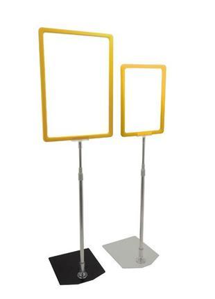 Комплект:стойка рамки А4 с металлическим основанием,высота 700...