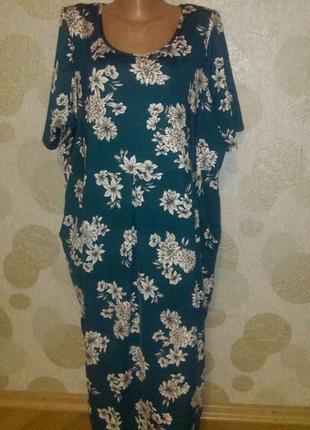 Красивое платье с карманами изумрудного цвета большого размера