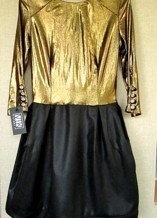 Красивое блестящее нарядное платье черно-золотое