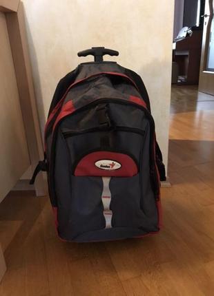 Cумка-рюкзак на колесах с выдвижной телескопической ручкой