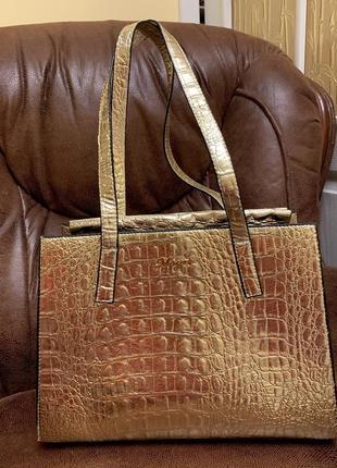 Шикарная кожаная золотая сумка