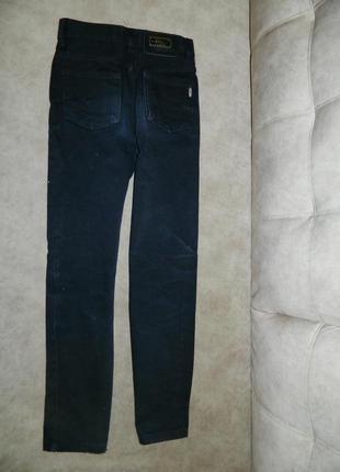 Штаны джинсы чёрные на мальчика-подростка smog.