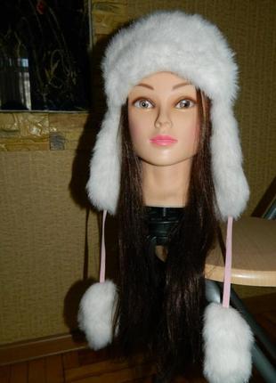 Зимняя шапка-ушанка для девочки розового цвета с белым мехом н...