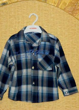 Детская рубашка в клеточку сине-голубая с длинным рукавом на м...