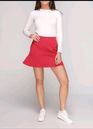 Розовая юбка с воланом