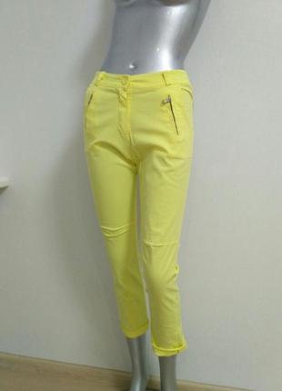 Брюки котоновые желтого цвета с молниями на карманах италия