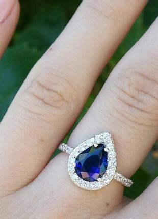 Кольцо капля с фианитами синий