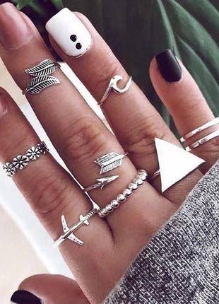 Набор колец 9 штук серебристого цвета ( кольцо цветок, самолет...