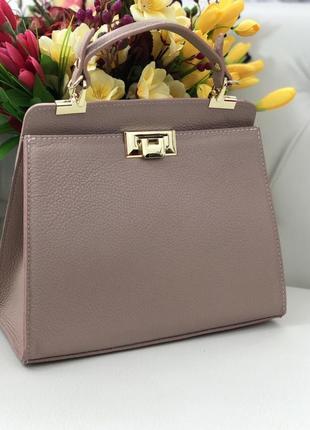 Красивая и удобная сумка среднего размера цвет пудра