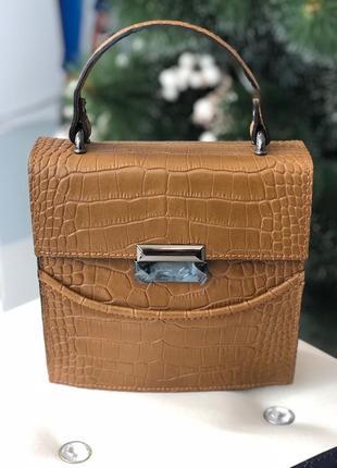 Стильная кожаная сумочка из новой коллекции