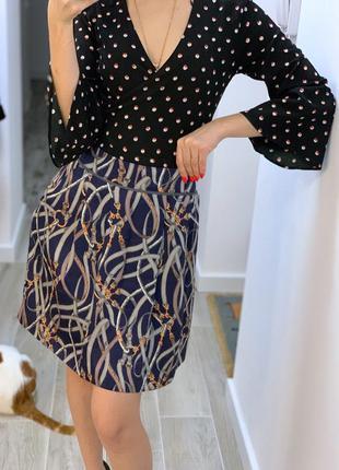 Шелковая юбка с карманами по бокам