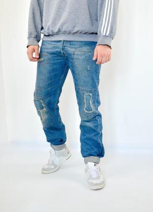 Levis 501 w32 l32 синие джинсы с рваностями и фабричными латками