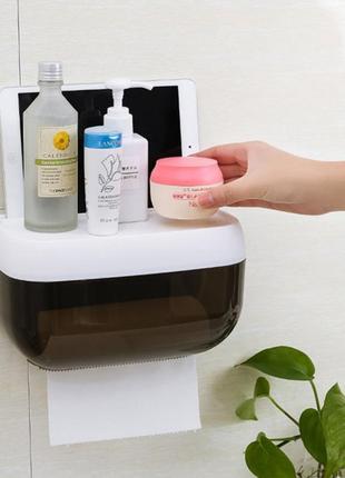 Пластиковый органайзер-держатель для туалетной бумаги с полочк...
