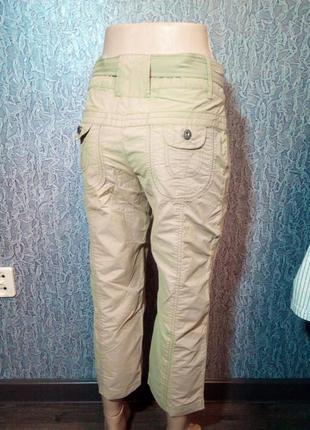 Женские брюки, бриджи капри.